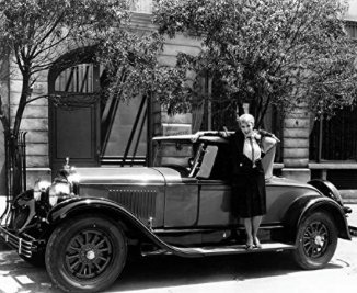 I couldn't find a picture of her car in 1917, but here she is in 1926. There's no word on if she drove this one.