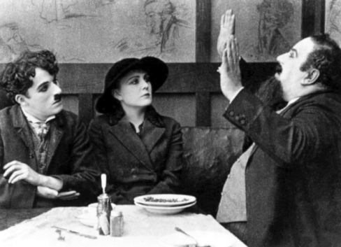 Bergman talks to Chaplin and Purviance in The Immigrant