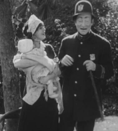 Dixie Chene and Charles Murray in Noise of Bombs (1914)